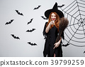 Halloween Concept - Happy elegant witch with 39799259