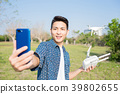 man with drone 39802655