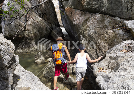 Brother and brother are climbing rock mountain and 39803844