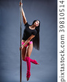Young girl pole dancer takes figure 39810514