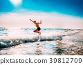 Boy Having Fun And Jumping In Sea Ocean Waves 39812709