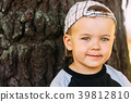 Happy Child Wearing Striped Cap In Outdoor 39812810