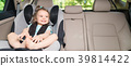Infant baby girl buckled into her car seat. 39814422
