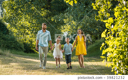 Happy family with two children holding hands 39821232