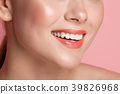 Female lower face stretching in smile 39826968