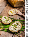 Homemade bread buttered with healthy seeds and herbs 39831100
