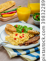 Scrambled eggs with toast and fresh salad 39832289