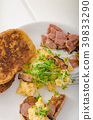 Scrambled eggs with French toast topped with watercress Scrambled eggs with watercress, french toast 39833290