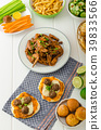 Sports feast - chicken wings, vegetable, french fries, pizza 39833566