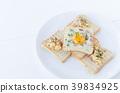 Fried egg inside toast, scrambled eggs 39834925
