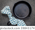 Empty cast iron skillet frying pan . 39843174