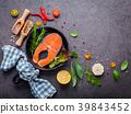 Salmon filet in old cast iron skille on dark stone 39843452
