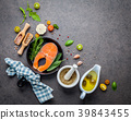 Salmon filet in old cast iron skille on dark stone 39843455