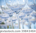 Empty wine glasses setting for wedding party. 39843464