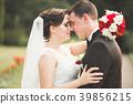 Stylish couple of happy newlyweds walking in the 39856215