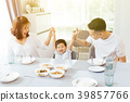 Happy Asian family raising child's hands and smile 39857766