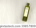 Olive oil bottle on wood background 39857809