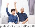 Senior Asian couple raising hands up at home 39857838