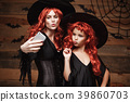 Halloween Concept - Beautiful caucasian mother and 39860703