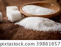 Close up a sugar cubes and cane 39861657