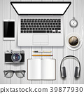 Laptop and office stationery on the table. 39877930