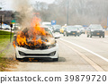 Burning car on fire on a highway road accident 39879720
