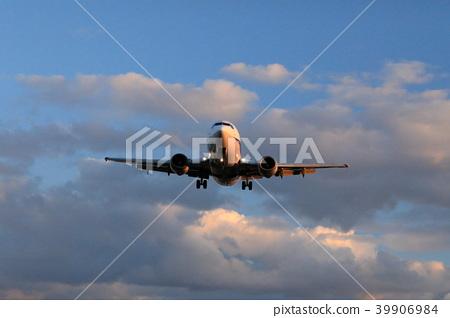 Shining airplane at sunset 39906984