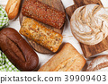 Various crusty bread and buns 39909403