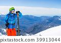 Panorama of sporty man with skis 39913044