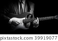 male musician in suit playing electric guitar 39919077