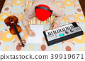 asian musician writing a song on bed 39919671