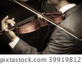 male musician playing violin on dark background 39919812