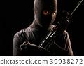 The Robber holding machine gun and hand grenade  39938272