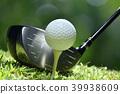 Golf ball on green grass ready to be struck 39938609