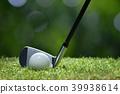Golf ball on green grass ready to be struck 39938614