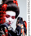 young pretty geisha in black kimono among sakura, asian ethno 39939962