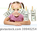 Cute little girl is playing with paper money 39940254