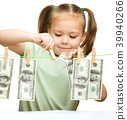 Cute little girl is playing with paper money 39940266