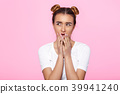 young woman on pink background Attractive beautiful woman showing air kiss 39941240