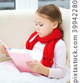 Ill little girl with thermometer is reading book 39942280