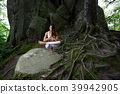 Young woman practiving yoga outdoors 39942905