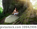 Young woman practiving yoga outdoors 39942906