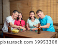 happy four friends while playing poker at table 39953306