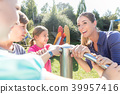 Family having fun at adventure playground in park 39957416