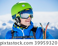 Portrait of sporty man with skis 39959320