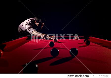 A man with a beard plays a big billiard. 39966600