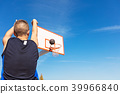 Young man shooting free throws from the foul line 39966840