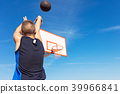 Young man shooting free throws from the foul line 39966841