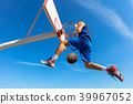 Slam Dunk. Side view of young basketball player making slam dunk 39967052