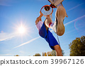 Slam Dunk. Side view of young basketball player making slam dunk 39967126